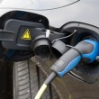 Electric car at charging station — Stock Photo