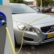 Stock Photo: Electric car at charging station