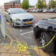 Stock Photo: Electric cars at charging station