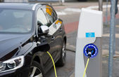Electric car at charging station — Foto Stock