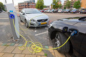 Electric cars at charging station — Stok fotoğraf