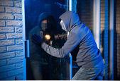 Burglar at work — Stock Photo
