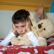Stock Photo: Boy angry on bed