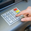 Stock Photo: Pin code at ATM machine