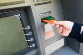 Bank card into ATM — Stock Photo