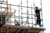 Scaffolding workers at work — Foto de Stock