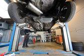 Car in garage — Stock Photo