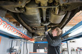 Repairing and checking a car — Stock fotografie