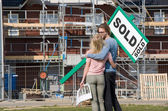 Young couple on construction site — Stock Photo