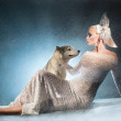 Snow maiden with dog — Stock Photo