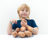 Boy with potatoes — Stock Photo