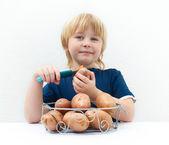 Boy with potatoes — Stock Photo