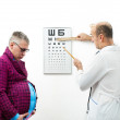 Doctor and pregnant patient — Stock Photo