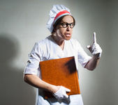 Chef with the cookbook — Stock Photo