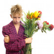 Sad teenager with bouquet — Stock Photo