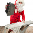 Santa Claus with steam iron — Stock Photo