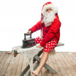 Stock Photo: Santa Claus with steam iron
