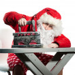 Stock Photo: Santa Claus with the iron