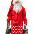 Tired SantClaus with irons — Stock Photo #35299133