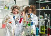 Cheerful chemists — Stock fotografie