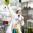 Stock Photo: Cheerful chemist