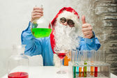 Santa Claus with flasks — Stock Photo