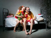 Loving couple on the bed — Stock Photo
