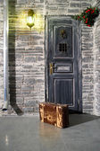 Suitcase at the door — Stockfoto