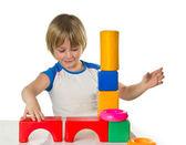 Boy with bricks — Stock Photo
