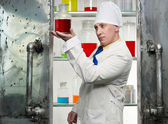 Chemist with beaker — Stock Photo