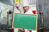 Chemist with blackboard — Stock Photo