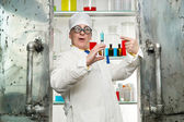 Chemist with syringe — Stock Photo
