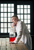 Physician with beaker — Stock Photo