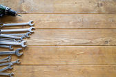 Set of wrenches and drill — Stock Photo