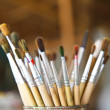 Old paint brushes in cans. — Stock Photo
