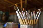 Old paint brushes in cans. — Foto de Stock