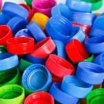 Colorful plastic bottle screw caps — Stock Photo