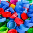 Colorful plastic bottle screw caps — Stock Photo