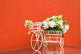 Bicycle with artificial flower — Stock Photo
