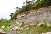 Rock slides along the street,thailand — Stock Photo