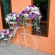 Fake flower on bicycle — Stock Photo