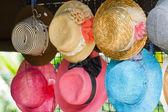 Pretty straw hat with flower — Stock Photo