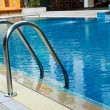 Stock Photo: Grab bars ladder in swimming pool