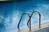 Grab bars ladder in swimming pool — Stock Photo