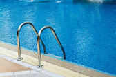 Grab bars ladder in swimming pool — Stock Photo
