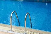 Grab bars ladder in swimming pool — Zdjęcie stockowe