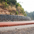 Stock Photo: Stone block to prevent landslides along road.