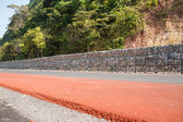 Stone block to prevent landslides along the road. — Stock Photo