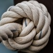 White rope tied into a knot. — Stock Photo