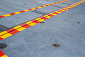 Red yellow line on the steel floor. — Stock Photo